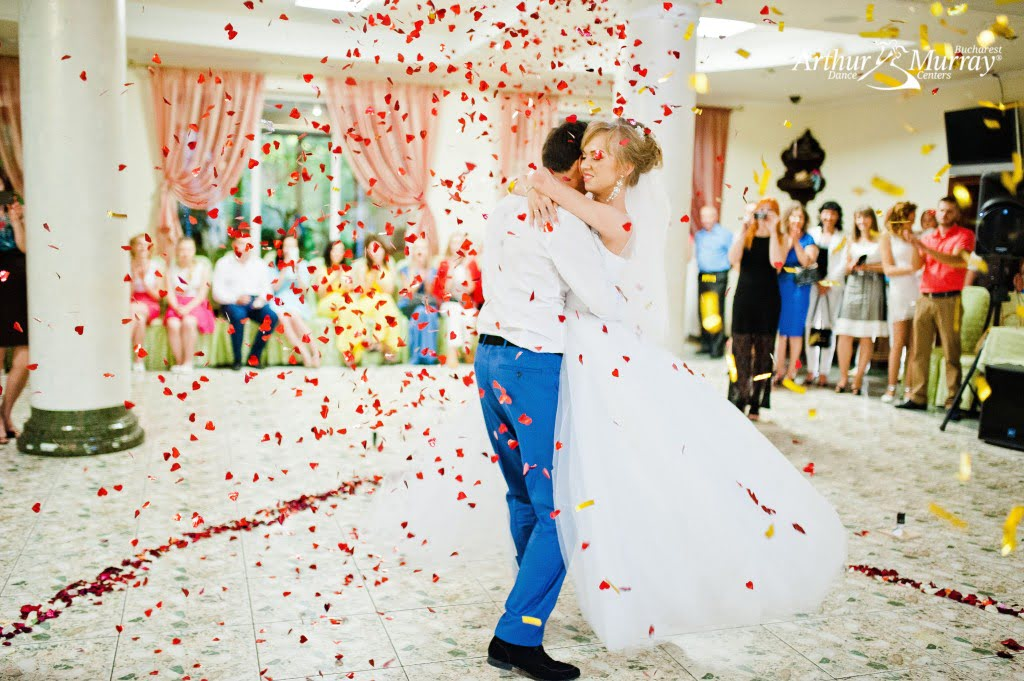45887408 - first wedding dance of couple in petals of rose